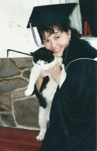 Meg Graduation photo with cat